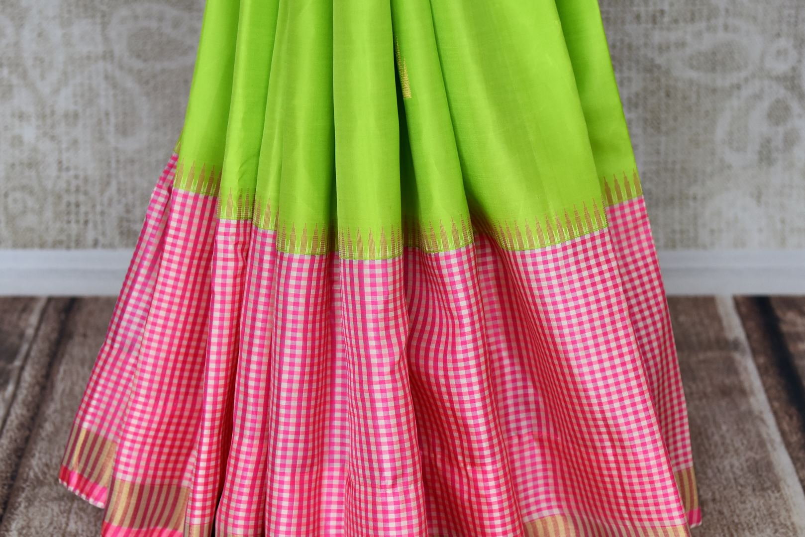Buy fluorescent green Kanjeevaram silk saree online in USA with pink check border. Shop more such exquisite Indian saris in USA from Pure Elegance. Get floored by a range of designer sarees, pure silk sarees, Kanchipuram silk saris at our Indian fashion store in USA.-pleats