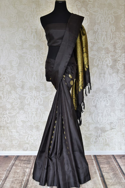 Buy elegant black Kanjivaram silk saree online in USA with golden zari work. Shop more such exquisite Indian saris in USA from Pure Elegance. Get floored by a range of designer sarees, pure silk sarees, Kanchipuram silk saris at our Indian fashion store in USA.-full view