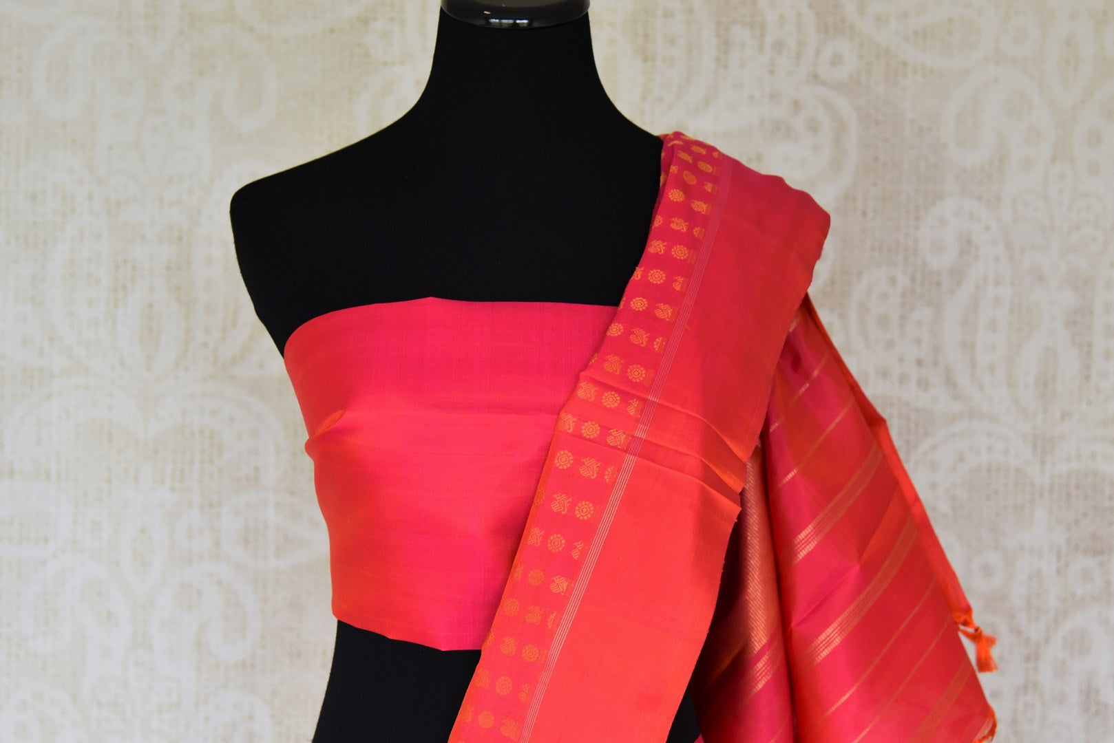 Buy orange pink Kanchipuram saree online in USA with peacock and flower zari buta. Shine bright in best of Indian designer sarees from Pure Elegance Indian fashion store in USA on special occasions. Choose from a splendid variety of Kanjivaram silk sarees, Banarasi sarees, pure handwoven saris. Shop online.-blouse pallu