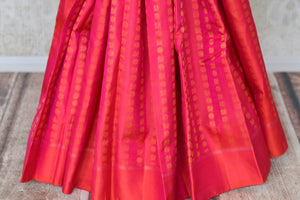 Buy orange pink Kanchipuram saree online in USA with peacock and flower zari buta. Shine bright in best of Indian designer sarees from Pure Elegance Indian fashion store in USA on special occasions. Choose from a splendid variety of Kanjivaram silk sarees, Banarasi sarees, pure handwoven saris. Shop online.-pleats