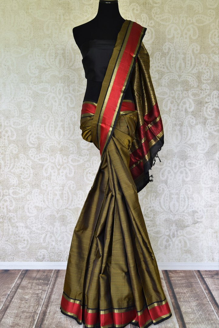 Buy mehendi green Kanjeevaram saree online in USA with red border. Make special occasions even more special with your captivating traditional style in Kanchipuram sarees from Pure Elegance Indian clothing in USA.-full view