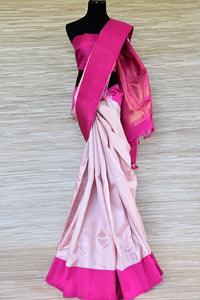 Buy powder pink Kanjivaram saree online in USA with solid pink border. Update your saree wardrobe with latest designs in Kanchipuram silk sarees from Pure Elegance Indian clothing in USA. Shop online now.-full view