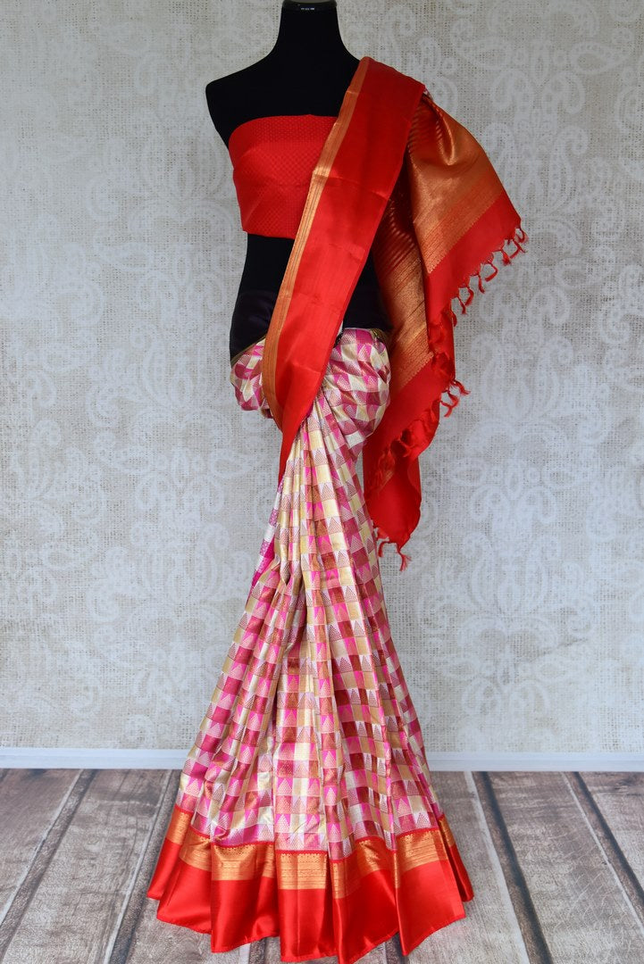 Shop pink and white Kanchipuram saree online in USA with red zari border. Shine bright in best of Indian designer sarees from Pure Elegance Indian fashion store in USA on special occasions. Choose from a splendid variety of Kanjivaram silk sarees, Banarasi sarees, pure handwoven saris. Shop online.-full view