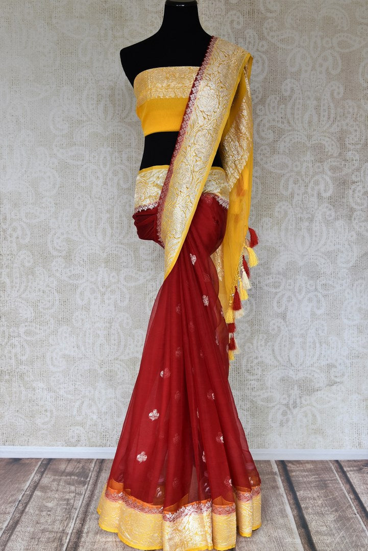 Shop maroon georgette Banarasi saree online in USA with yellow zari border. Elevate your traditional saree style with beautiful Indian Banarasi saris from Pure Elegance Indian fashion store in USA. We also have a stunning variety of bridal saris for Indian brides in USA. Shop now.-full view