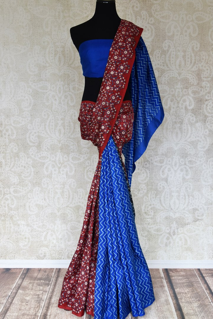 Buy red floral and blue zigzag stripes block print silk saree online in USA. Enhance your ethnic style with exquisite Indian handloom sarees from Pure Elegance Indian clothing store in USA. Pick from a range of vibrant silk saris, Banarasi sarees, Kanchipuram sarees for a stunning ethnic style.-full view