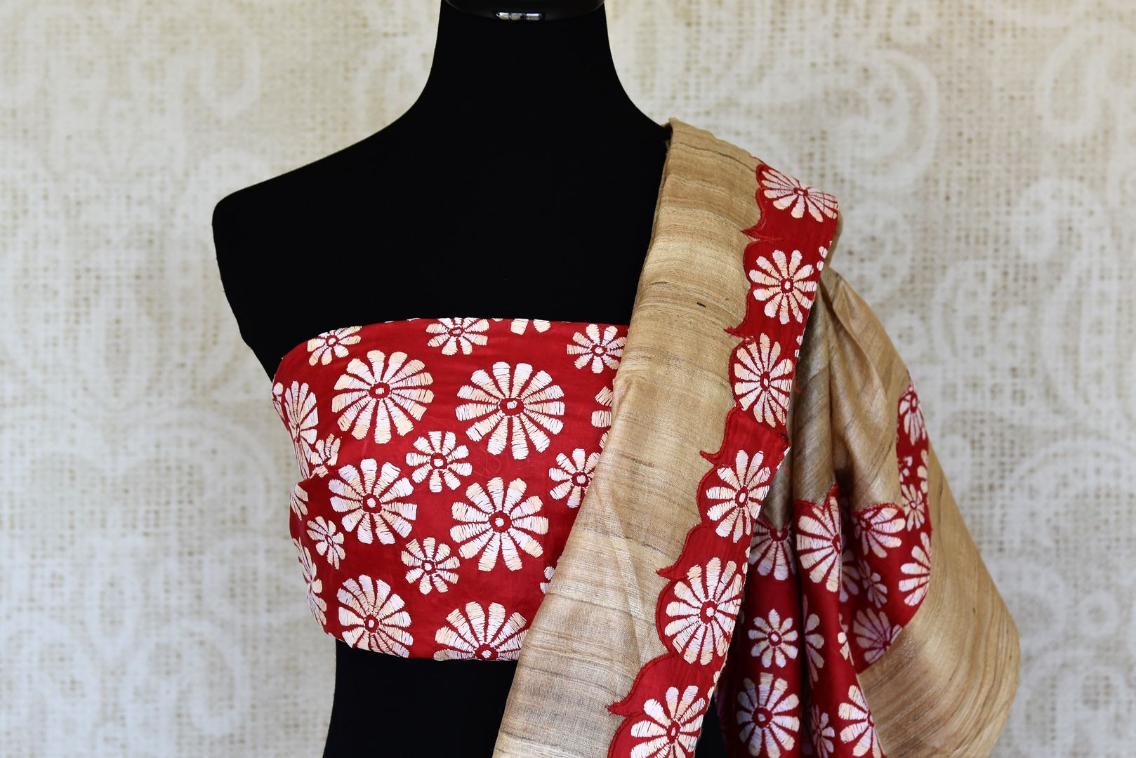 Buy beige and red floral Kantha work tussar saree online in USA. Enhance your ethnic style with exquisite Indian handloom sarees from Pure Elegance Indian clothing store in USA. Pick from a range of vibrant silk sarees, Banarasi saris, Kanchipuram sarees for a stunning ethnic style.-blouse pallu