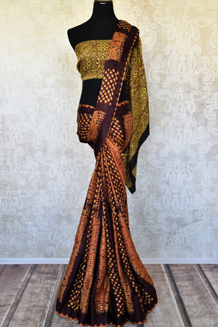 Buy brinjal and orange color Ajrak and Bandhej saree online in USA. Feel traditional in beautiful Indian designer sarees from Pure Elegance Indian fashion store in USA on special occasions. Choose from a splendid variety of Banarasi sarees, pure handwoven saris. Buy online.-full view