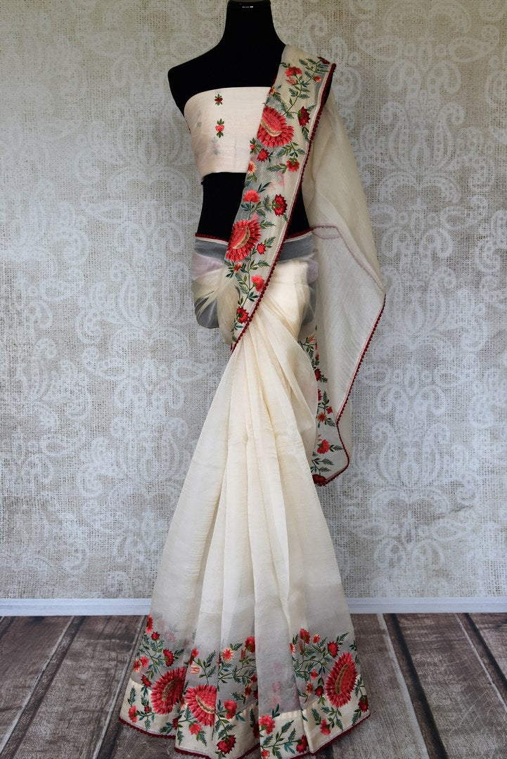 Shop off-white floral embroidery organza sari online in USA. Raise your ethnic style quotient at weddings and special occasions with exquisite Indian sarees from Pure Elegance Indian clothing store in USA. Pick from a tasteful collection of handloom sarees, pure silk sarees, Banarasi saris and much more. Shop now.-full view