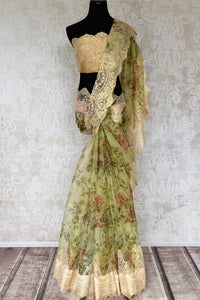 Shop green floral print organza sari online in USA with net border. Keep your wardrobe update with latest Indian handwoven sarees from Pure Elegance Indian fashion store in USA. Shop beautiful Benarasi saris, pure silk sarees, Kanchipuram sarees for Indian women in USA from our online store.-full view