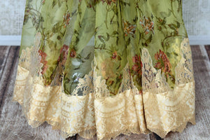 Shop green floral print organza sari online in USA with net border. Keep your wardrobe update with latest Indian handwoven sarees from Pure Elegance Indian fashion store in USA. Shop beautiful Benarasi saris, pure silk sarees, Kanchipuram sarees for Indian women in USA from our online store.-pleats