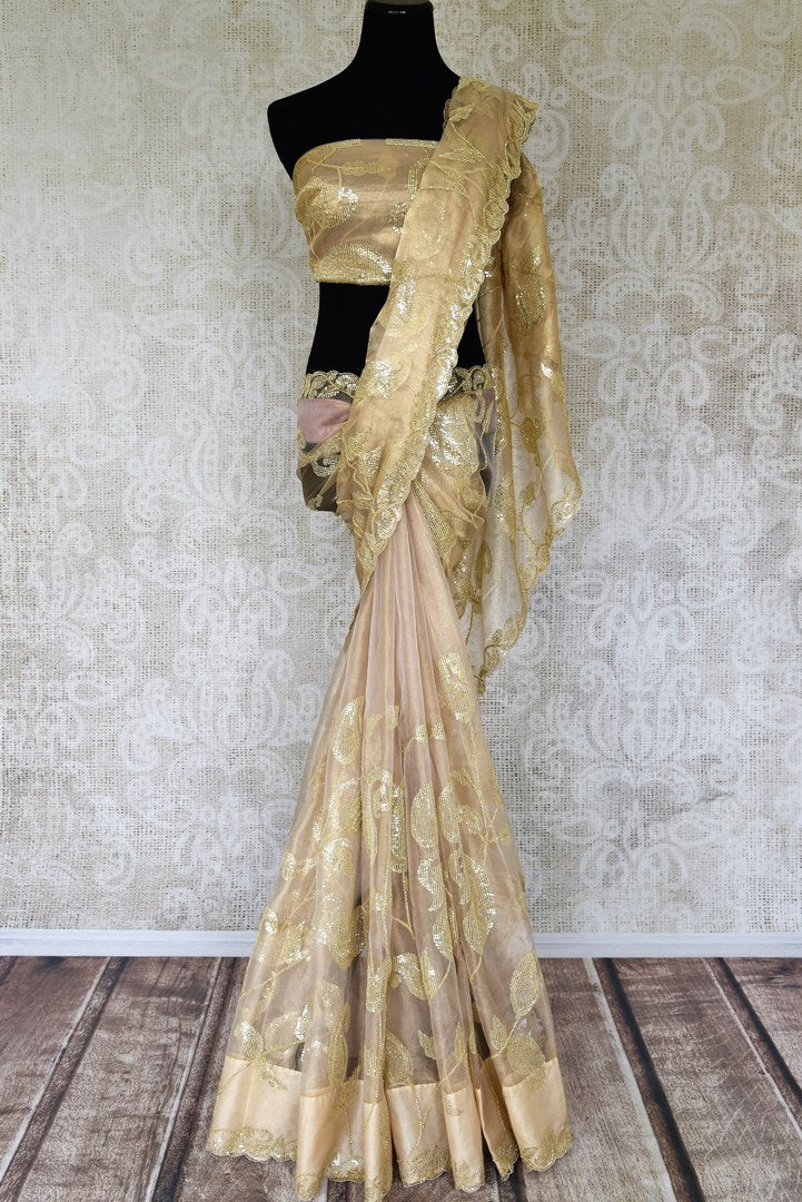 Shop beige zari tissue saree online in USA with sequin work. Relive tradition in Indian designer sarees from Pure Elegance Indian fashion store in USA. Enhance your style with pure silk sarees, Kanchipuram sarees, handloom sarees available online.-full view
