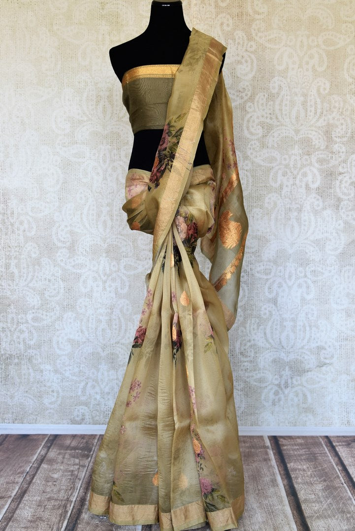 Shop olive green organza sari online in USA with floral print. Keep your wardrobe update with latest Indian handwoven sarees from Pure Elegance Indian fashion store in USA. Shop beautiful Benarasi saris, pure silk sarees, Kanchipuram sarees for Indian women in USA from our online store.-full view