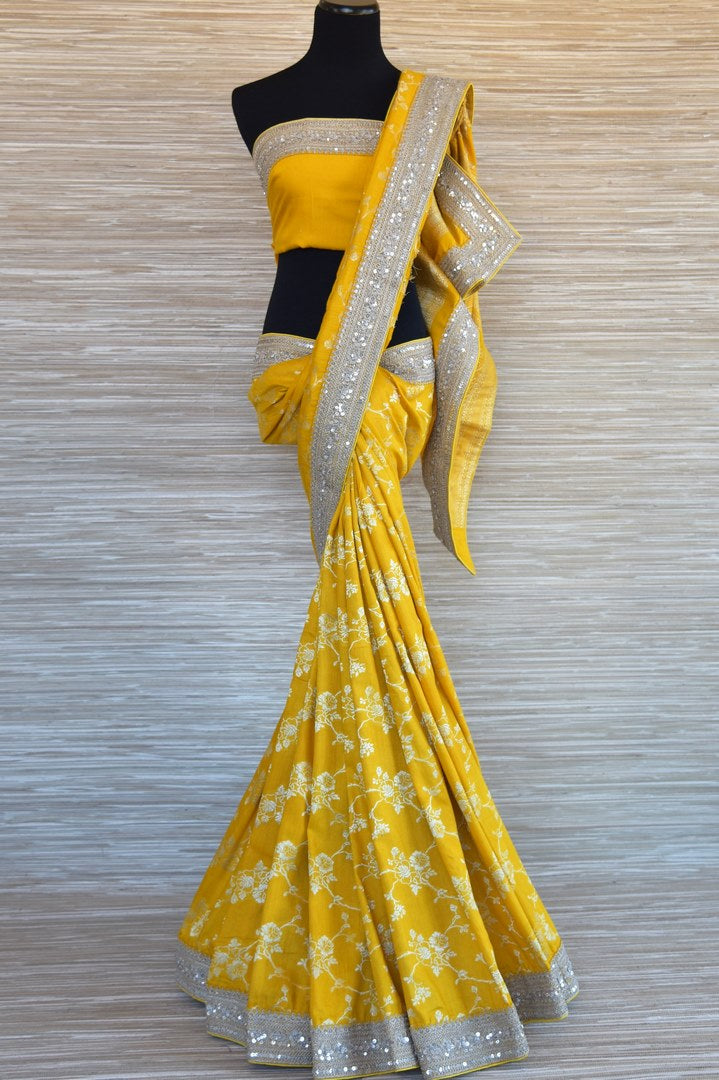 Buy yellow muga Banarasi saree online in USA with embroidered border. Select your favorite Indian sarees, Banarasi silk sarees, wedding sarees from Pure Elegance Indian fashion store in USA for weddings and special occasions.-full view