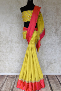 Shop yellow gota work silk sari online in USA with pink border. Keep your wardrobe update with latest Indian saris from Pure Elegance Indian fashion store in USA. Shop beautiful Indian designer sarees, pure silk sarees, Kanchipuram sarees for Indian women in USA from our online store.-full view