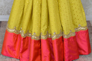 Shop yellow gota work silk sari online in USA with pink border. Keep your wardrobe update with latest Indian saris from Pure Elegance Indian fashion store in USA. Shop beautiful Indian designer sarees, pure silk sarees, Kanchipuram sarees for Indian women in USA from our online store.-pleats