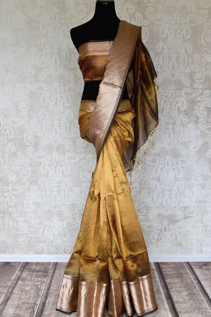 Buy golden tissue linen copper border Banarasi saree online in USA with floral print. Enhance your ethnic style with exquisite Indian handloom saris from Pure Elegance Indian clothing store in USA. Pick from a range of vibrant silk sarees, Banarasi sarees, Kanchipuram silk sarees for a stunning ethnic style.-full view