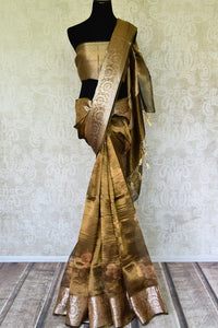 Shop golden green printed tissue linen sari online in USA with golden border. Update your saree wardrobe with stunning Indian handwoven sarees from Pure Elegance Indian fashion store in USA. Shop now.-full view