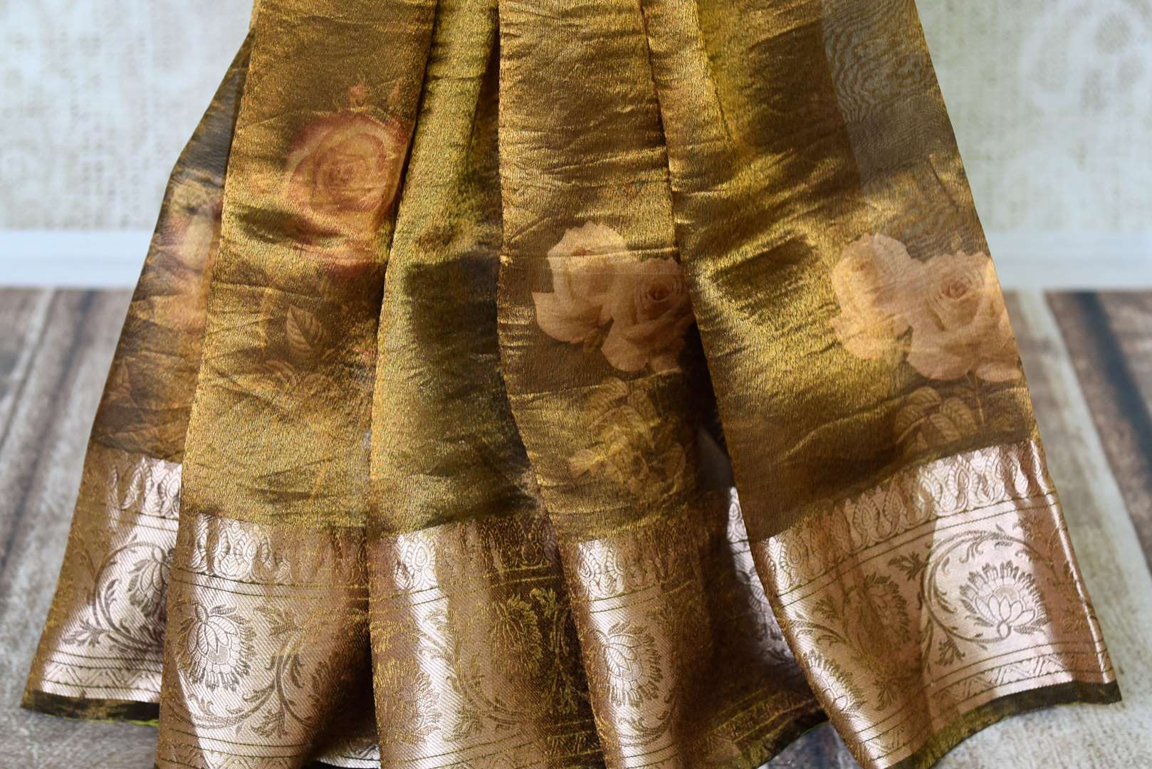 Shop golden green printed tissue linen sari online in USA with golden border. Update your saree wardrobe with stunning Indian handwoven sarees from Pure Elegance Indian fashion store in USA. Shop now.-pleats