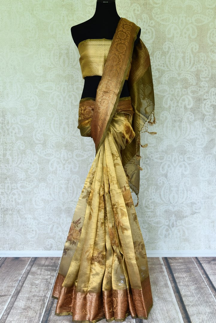 Shop stunning golden green floral tissue linen sari online in USA with golden border. Update your saree wardrobe with stunning Indian handwoven sarees from Pure Elegance Indian fashion store in USA. Shop now.-full view