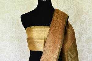 Shop stunning golden green floral tissue linen sari online in USA with golden border. Update your saree wardrobe with stunning Indian handwoven sarees from Pure Elegance Indian fashion store in USA. Shop now.-blouse pallu
