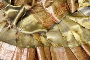 Shop stunning golden green floral tissue linen sari online in USA with golden border. Update your saree wardrobe with stunning Indian handwoven sarees from Pure Elegance Indian fashion store in USA. Shop now.-details