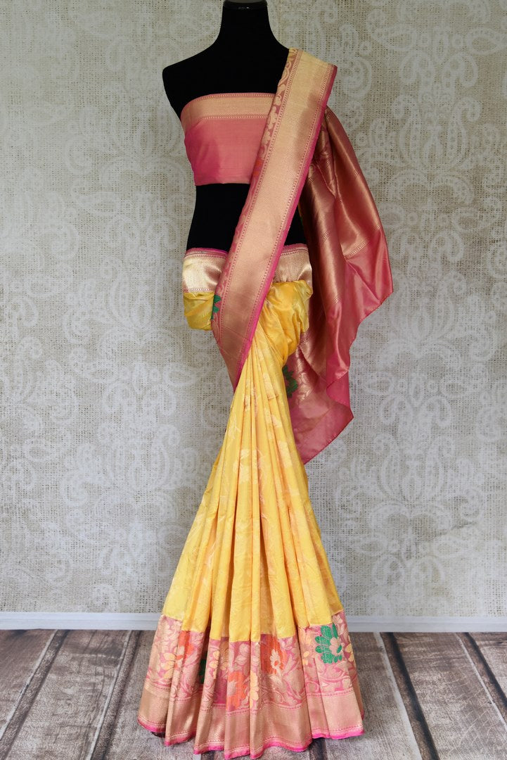 Buy beautiful yellow Banarasi silk saree online in USA with pink zari minakari floral border. Choose your favorite Indian sarees, Banarasi sarees, silk saris from an exquisite collection available at Pure Elegance Indian clothing store in USA.-full view