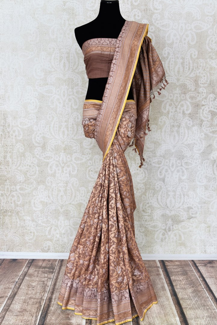 Beautiful brown Jamdani Banarasi saree for online shopping in USA. Get floored by a vibrant collection of Indian designer sarees at Pure Elegance Indian fashion store in USA. Choose from a beautiful range of Indian handloom saris, silk saris, Banarasi sarees for weddings and special occasions.-full view
