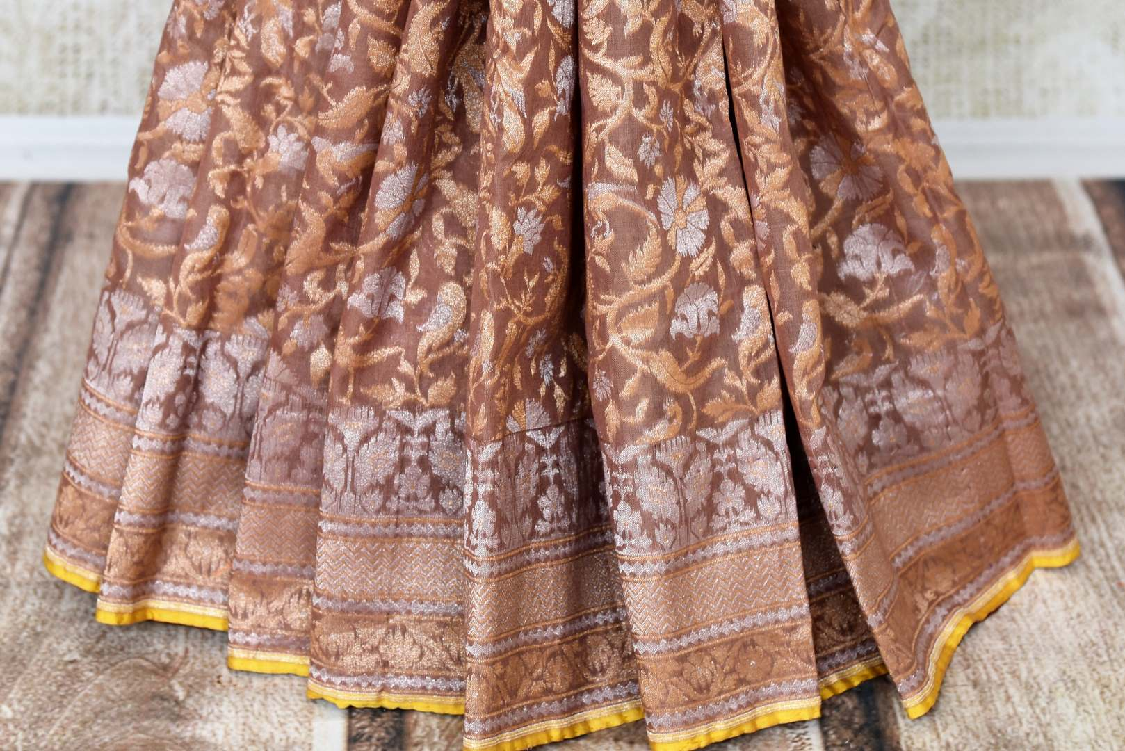Beautiful brown Jamdani Banarasi saree for online shopping in USA. Get floored by a vibrant collection of Indian designer sarees at Pure Elegance Indian fashion store in USA. Choose from a beautiful range of Indian handloom saris, silk saris, Banarasi sarees for weddings and special occasions.-pleats