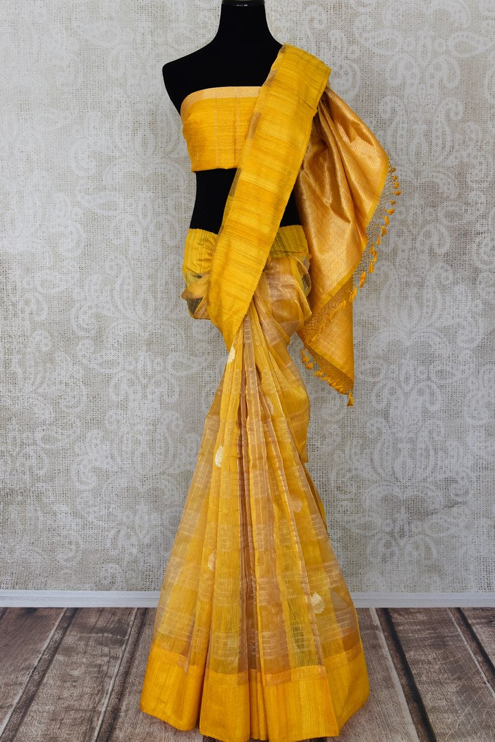 Yellow organza Banarasi saree for online shopping in USA with zari checks and zari buta. Get floored by a vibrant collection of Indian designer sarees at Pure Elegance Indian fashion store in USA. Choose from a beautiful range of Indian handloom saris, silk saris, Banarasi sarees for weddings and special occasions.-full view