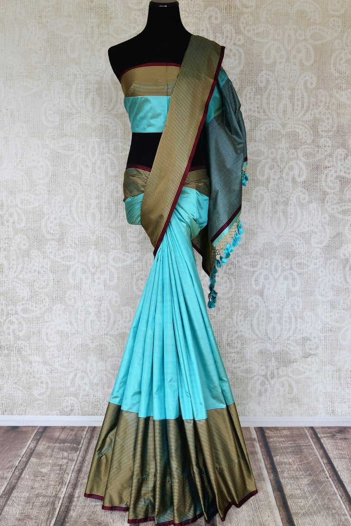 Shop turquoise blue Banarasi silk saree online in USA with striped border. Keep your wardrobe update with latest Indian handwoven sarees from Pure Elegance Indian fashion store in USA. Shop traditional Benarasi sarees, pure silk sarees for Indian women in USA from our online store.-full view