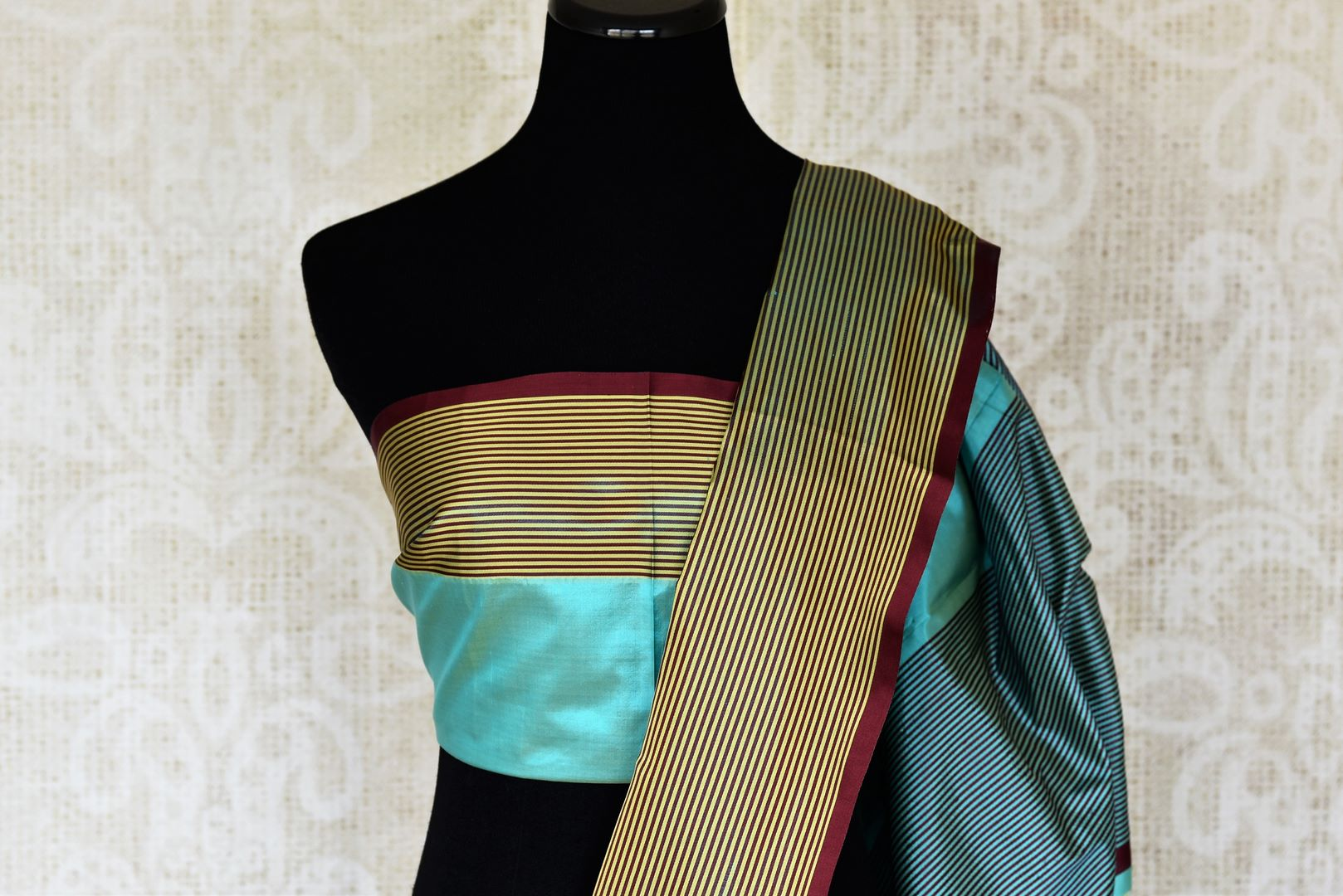 Shop turquoise blue Banarasi silk saree online in USA with striped border. Keep your wardrobe update with latest Indian handwoven sarees from Pure Elegance Indian fashion store in USA. Shop traditional Benarasi sarees, pure silk sarees for Indian women in USA from our online store.-blouse pallu