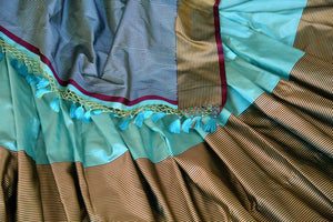 Shop turquoise blue Banarasi silk saree online in USA with striped border. Keep your wardrobe update with latest Indian handwoven sarees from Pure Elegance Indian fashion store in USA. Shop traditional Benarasi sarees, pure silk sarees for Indian women in USA from our online store.-details