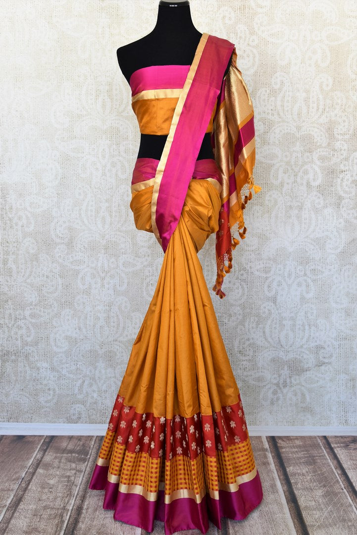 Mustard Benarasi silk saree for online shopping in USA with zari buta and check border. Get floored by a vibrant collection of Indian designer sarees at Pure Elegance Indian fashion store in USA. Choose from a beautiful range of Indian handloom sarees, silk saris, Banarasi sarees for weddings and special occasions.-full view
