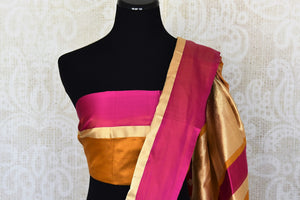 Mustard Benarasi silk saree for online shopping in USA with zari buta and check border. Get floored by a vibrant collection of Indian designer sarees at Pure Elegance Indian fashion store in USA. Choose from a beautiful range of Indian handloom sarees, silk saris, Banarasi sarees for weddings and special occasions.-blouse pallu