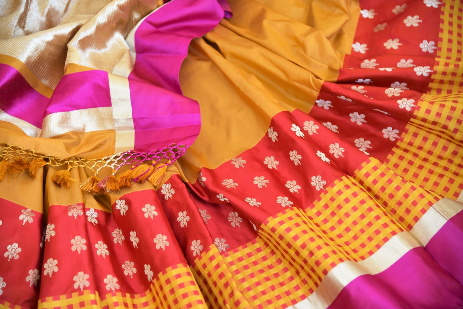 Mustard Benarasi silk saree for online shopping in USA with zari buta and check border. Get floored by a vibrant collection of Indian designer sarees at Pure Elegance Indian fashion store in USA. Choose from a beautiful range of Indian handloom sarees, silk saris, Banarasi sarees for weddings and special occasions.-details