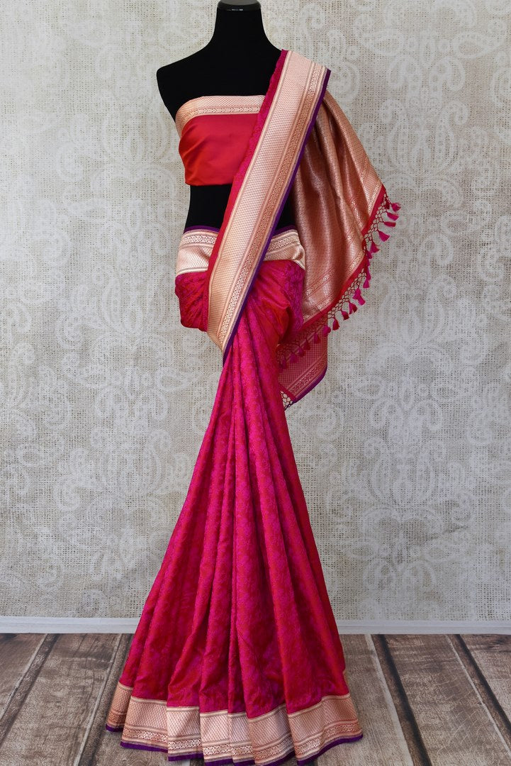 Pinkish red Banarasi silk sari for online shopping in USA with golden zari border and pallu. Get floored by a vibrant collection of Indian designer sarees at Pure Elegance Indian fashion store in USA. Choose from a beautiful range of Indian handloom sarees, silk saris, Banarasi sarees for weddings and special occasions-full view