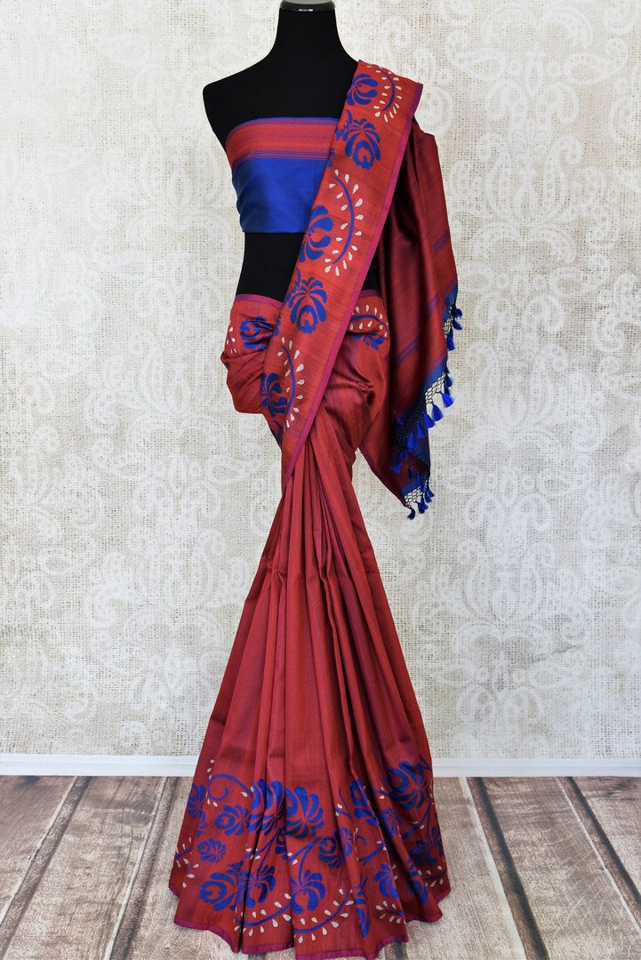 Maroon tussar silk sari for online shopping in USA with blue floral design on border. Get floored by a vibrant collection of Indian designer sarees at Pure Elegance Indian fashion store in USA. Choose from a beautiful range of Indian handloom sarees, silk saris, Banarasi sarees for weddings and special occasions.-full view