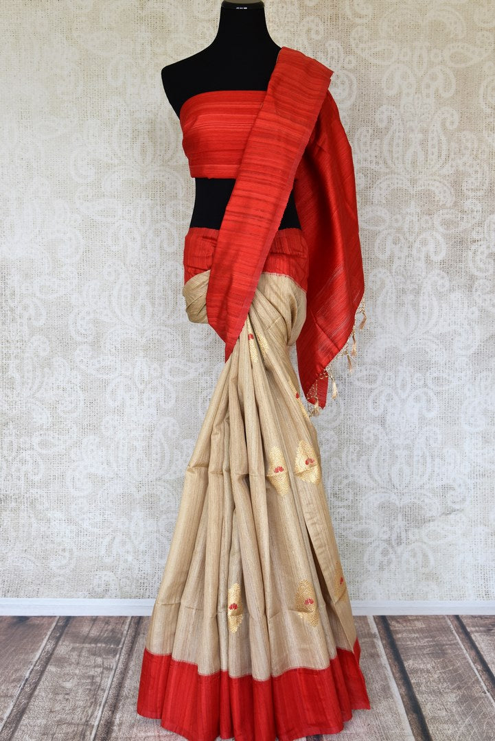 Shop beige tussar Banarasi saree online in USA with zari buta. Keep your wardrobe update with latest Indian handwoven saris from Pure Elegance Indian fashion store in USA. Shop beautiful Benarasi sarees, pure silk sarees, Kanchipuram sarees for Indian women in USA from our online store.-full view