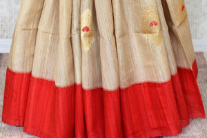 Shop beige tussar Banarasi saree online in USA with zari buta. Keep your wardrobe update with latest Indian handwoven saris from Pure Elegance Indian fashion store in USA. Shop beautiful Benarasi sarees, pure silk sarees, Kanchipuram sarees for Indian women in USA from our online store.-pleats