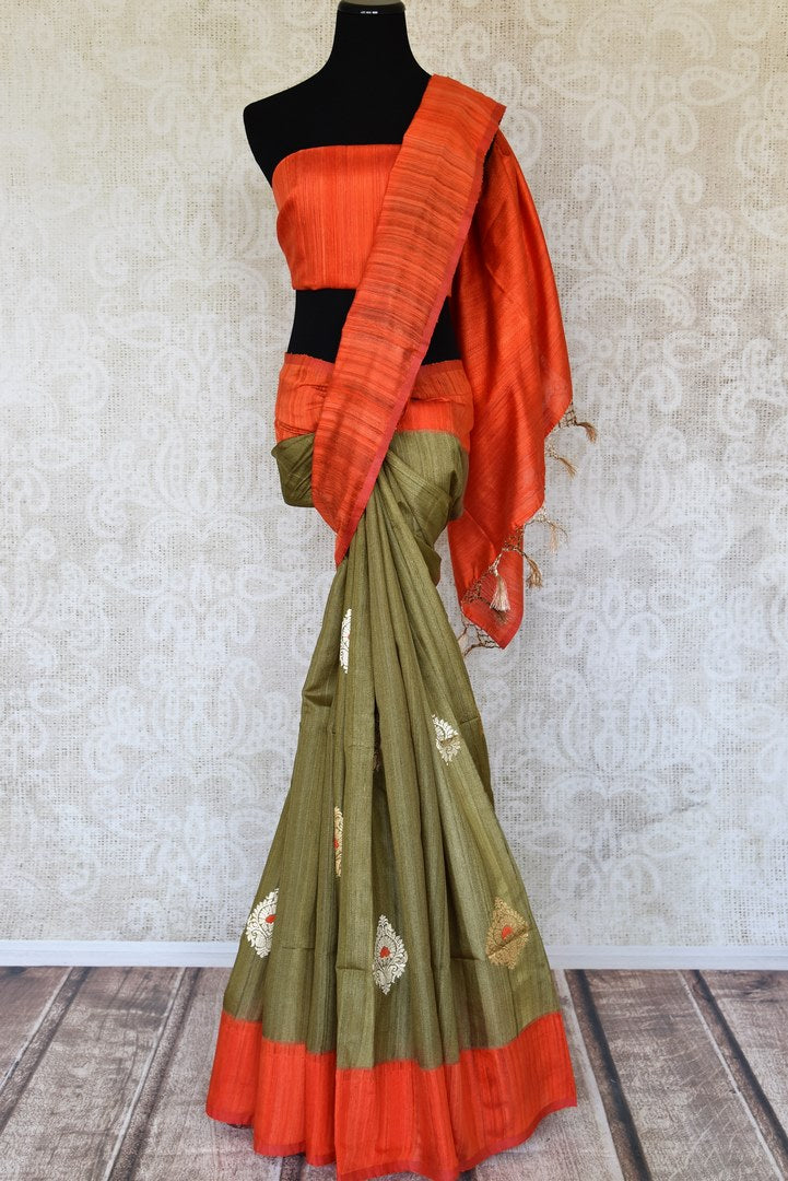 Shop olive green tussar Benarasi saree online in USA with red border and zari buta. Keep your wardrobe update with latest Indian handwoven saris from Pure Elegance Indian fashion store in USA. Shop beautiful Benarasi sarees, pure silk sarees, Kanchipuram sarees for Indian women in USA from our online store.-full view