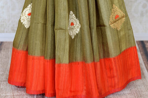 Shop olive green tussar Benarasi saree online in USA with red border and zari buta. Keep your wardrobe update with latest Indian handwoven saris from Pure Elegance Indian fashion store in USA. Shop beautiful Benarasi sarees, pure silk sarees, Kanchipuram sarees for Indian women in USA from our online store.-pleats