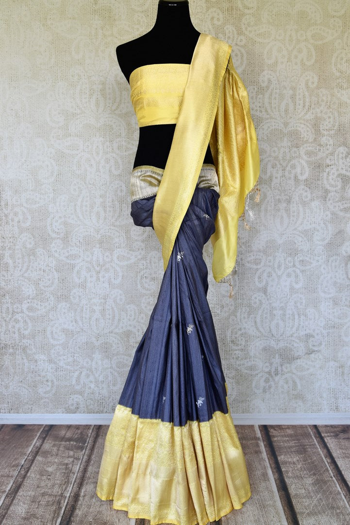 Buy blue tussar Banarasi saree online in USA with yellow zari border and pallu. Radiate traditional charm with beautiful Banarasi saris from Pure Elegance Indian clothing store in USA. Choose from a variety of Banarasi silk sarees, Banarasi georgette saris, Banarasi tussar sarees for special occasions.-full view