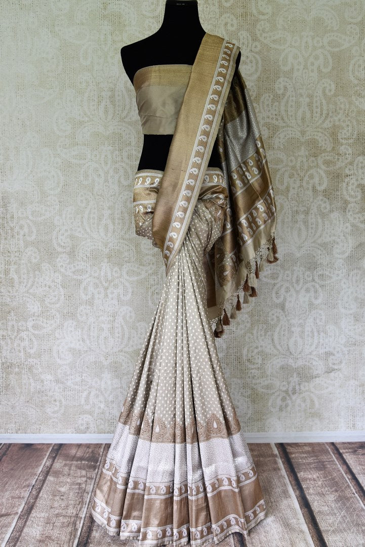 Buy traditional grey Banarasi silk saree online in USA with heavy zari border. Channel your inner Indian diva with a range exquisite traditional Banarasi silk saris from Pure Elegance Indian fashion store in USA. Shop now.-full view