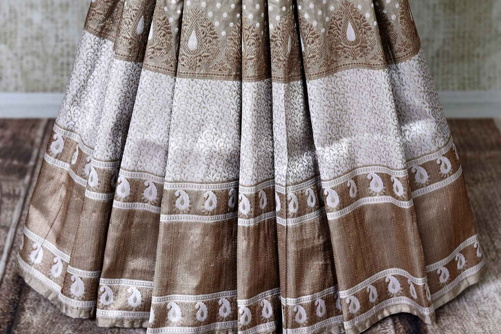 Buy traditional grey Banarasi silk saree online in USA with heavy zari border. Channel your inner Indian diva with a range exquisite traditional Banarasi silk saris from Pure Elegance Indian fashion store in USA. Shop now.-pleats