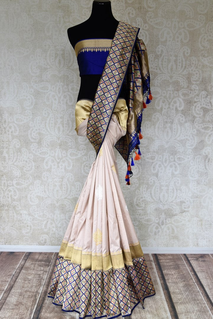 Buy cream Banarasi silk sari online in USA with heavy zari minakari border. Raise your ethnic style quotient at weddings and special occasions with exquisite Indian sarees from Pure Elegance Indian clothing store in USA. Pick from a tasteful collection of designer sarees, Banarasi saris, silk sarees. Shop now.-full view