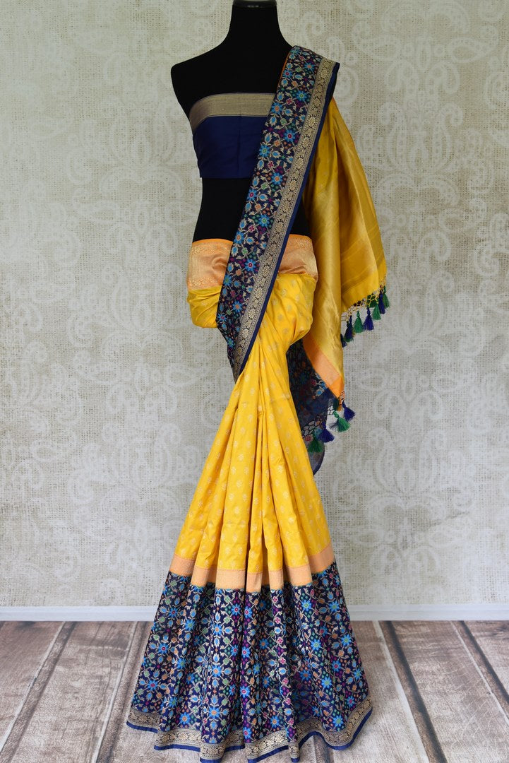 Shop yellow Benarasi silk saree online in USA with heavy blue floral zari minakari border. Channel your inner Indian diva with a range exquisite traditional Banarasi silk saris from Pure Elegance Indian fashion store in USA. Shop now.-full view