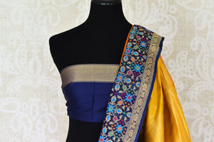 Shop yellow Benarasi silk saree online in USA with heavy blue floral zari minakari border. Channel your inner Indian diva with a range exquisite traditional Banarasi silk saris from Pure Elegance Indian fashion store in USA. Shop now.-blouse pallu