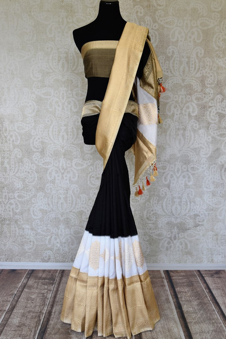 Buy black and white Banarasi silk saree online in USA with golden zari border. Raise your ethnic style quotient at weddings and special occasions with exquisite Indian sarees from Pure Elegance Indian clothing store in USA. Pick from a tasteful collection of designer sarees, Banarasi saris, silk sarees. Shop now.-full view