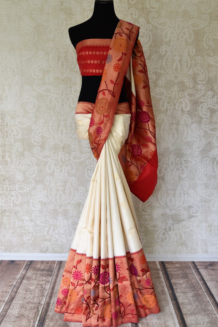 Shop off-white Banarasi silk saree online in USA with red minakari zari border. Update your saree wardrobe with stunning Banarasi sarees from Pure Elegance Indian fashion store in USA. Shop now.-full view