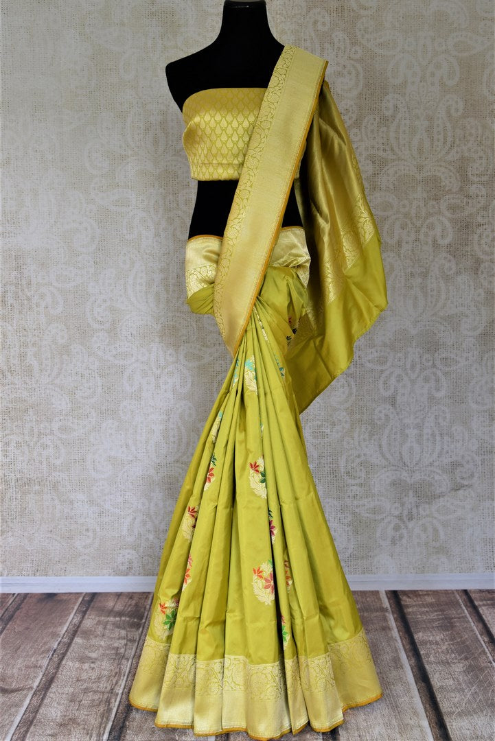 Buy stunning pistachio green Banarsi silk saree online in USA with minakari zari floral buta. Make your saree wardrobe rich and colorful with stunning handwoven sarees, pure silk sarees, designer sarees from Pure Elegance Indian clothing store in USA.-full view